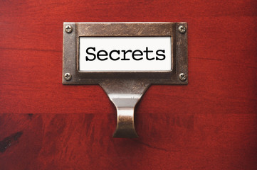 Lustrous Wooden Cabinet with Secrets File Label