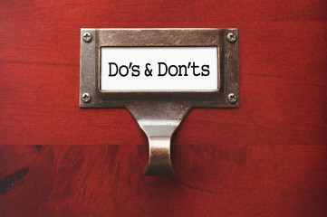 Lustrous Wooden Cabinet with Do's and Don'ts File Label