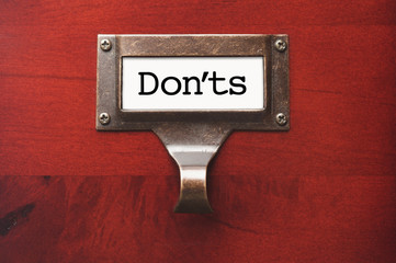 Lustrous Wooden Cabinet with Don'ts File Label