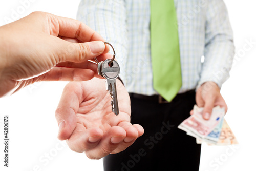 Business exchange with money and keys.