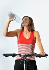 a woman drinks water from bottle