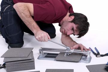 Man cutting tiles