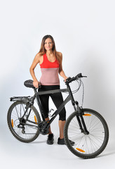 a woman and a mountain bike