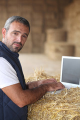 Farmer working at a laptop computer