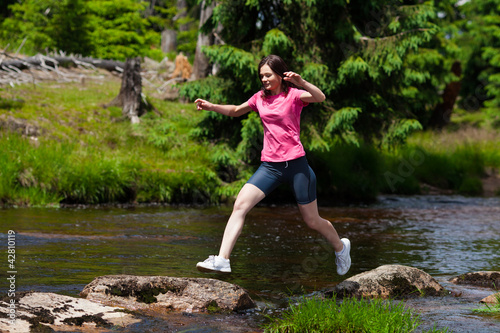 Woman running, jumping outdoor