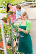Florist at garden center retail inventory