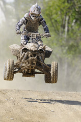 quad jump dusty road