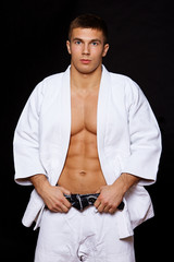 Portrait of judo fighter posing in studio