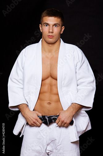 Portrait of judo fighter posing in studio