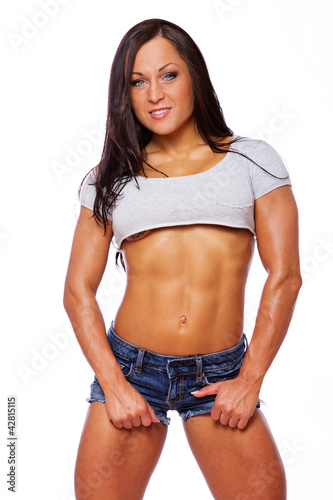 Portrait of muscle woman posing in gym