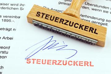 Holzstempel auf Dokument: Steuerzuckerl