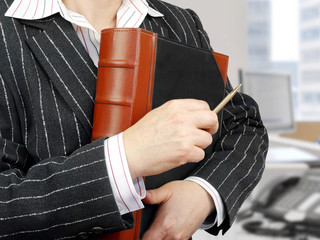 Businesswoman with leather folder ready for meeting