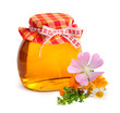 Fresh honey in a glass jar