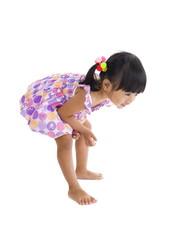 cute girl sees something on the floor