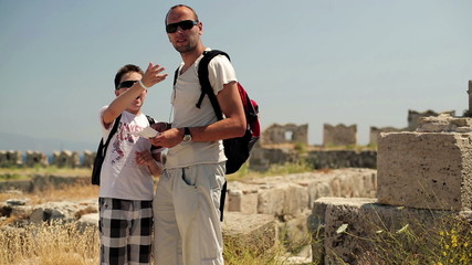 Father with teenage son sightseeing ancient wals