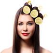 Beautiful brunnete with lemons in her hairstyle