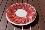 Salchichon, Chorizo and Cabecero sausage on plate