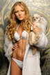 beautiful woman in fur coat with chihuahua dog.