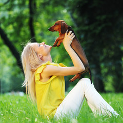 woman dachshund in her arms