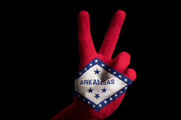 arkansas us state flag two finger up gesture for victory and win