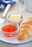 Red caviar and croissant