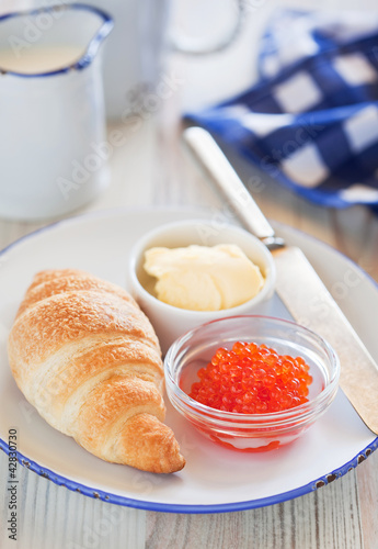 Red caviar and croissant for breakfast