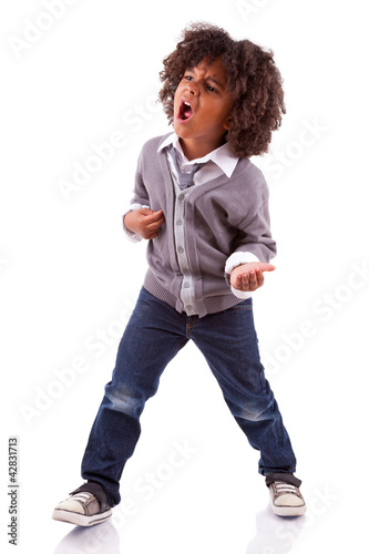 Little african american boy playing air guitar