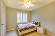 Beige bedroom with kids bed.