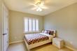 Beige bedroom with kids bed.
