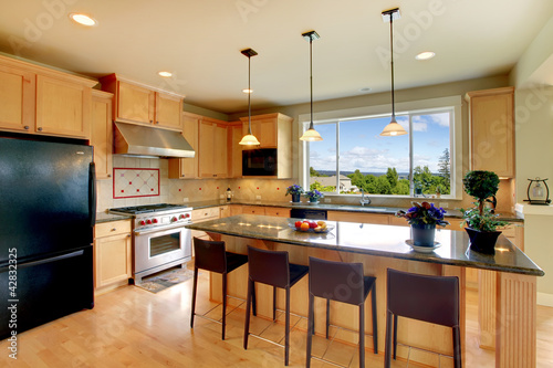 Luxury classic wood kitchen with island and chairs.