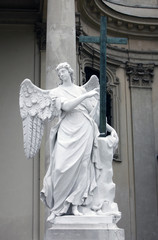 Angel in front of Karlskirche church in Vienna, Austria