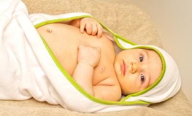 Clean baby in towel