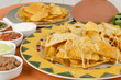 Cheesy Nachos with refried beans, guacamole, salsa & sour cream