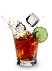 Ice cube and lime splashing cola glass, Cuba Libre drink