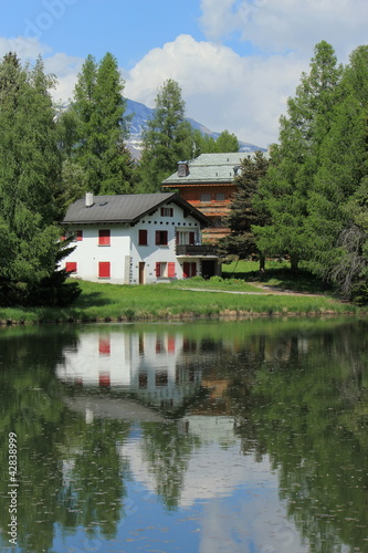 Houses and white lake at Crans Montana, by summer