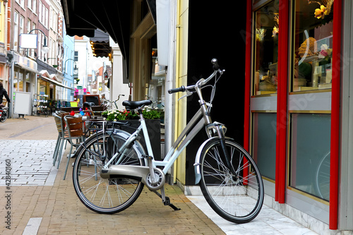 Bicycle Bike is parked near shop in Gorinchem. Netherlands
