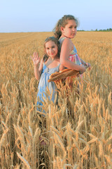 Two girl in the wheat field