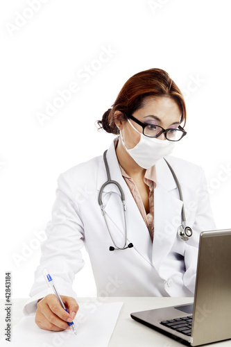 Female doctor write a prescription