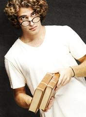 man holding books