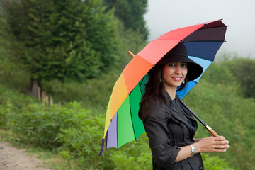 Beautiful Lady with Hat and Umbrella
