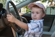 The baby at steering wheel