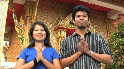 Asian Man And Woman Do Thai Greeting