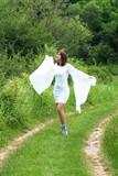 happy woman in white dress