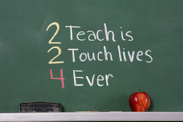 Teacher inspirational phrase on chalkboard