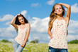 Two happy young women enjoying sun