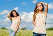 Two happy young women enjoying sun