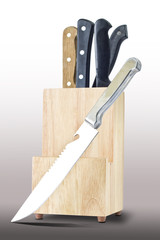Knifes and wooden box isolated on gray background