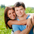 Young happy couple embracing and smiling outdoor