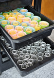 Metallic and plastic curlers close-up.Heaps of the metallic and  - 42858930