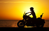 Woman biker over sunset